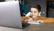 boy on computer stock